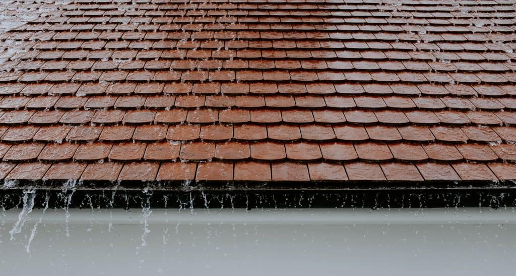 Image of water running off of a roof