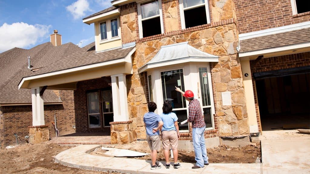 Home Inspector Inspecting Home with buyer